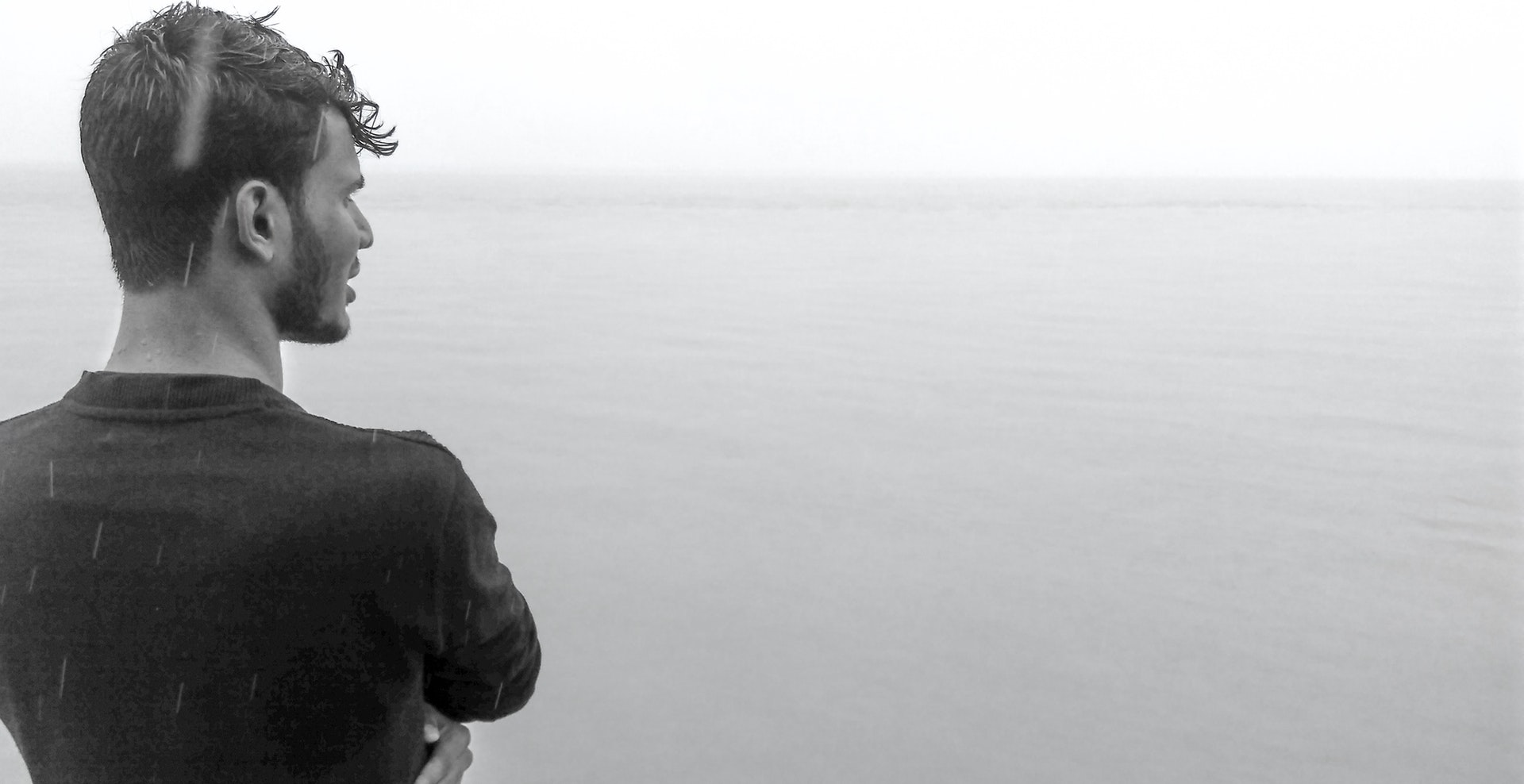 young man looking out into ocean