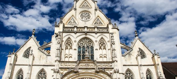 cathedral in front of cloudy blue skies